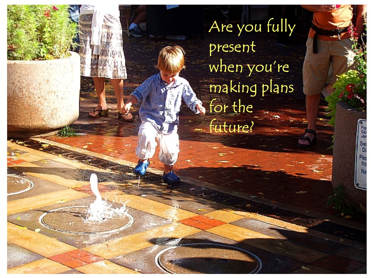 Little boy about to stop in puddle of fountain